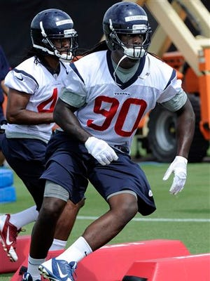 Houston's Jadeveon Clowney, the top pick in the 2014 NFL draft, runs a drill during preseason workouts. The Texans hope Clowney, when he recovers from hernia surgery, will dominate the headlines in Houston because of his play.