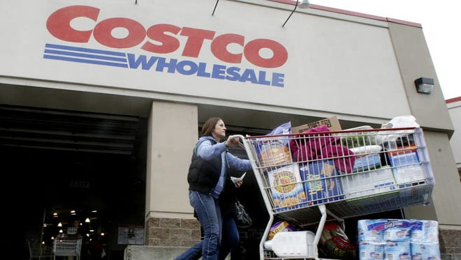 A shopper leaves a Costco store in Portland, Ore.