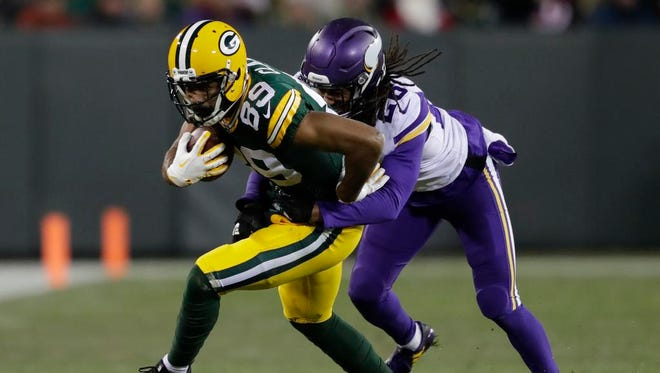 Green Bay Packers wide receiver Michael Clark (89) makes a catch against Minnesota Vikings cornerback Trae Waynes (26) in the fourth quarter Saturday, December 23, 2017, at Lambeau Field in Green Bay, Wis.