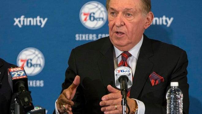 """From Dec. 7, 2015, Naismith Memorial Basketball Hall of Fame member and Chairman of the Board of Directors for USA Basketball Jerry Colangelo, right, talks to the media as he will be joining the Philadelphia 76ers as the Special Advisor to the Managing General Partner and Chairman of Basketball Operations in Philadelphia. USA Basketball is hoping that the rescheduled Tokyo Olympics will be held around the same time next year as they would have been this year. USA Basketball managing director Jerry Colangelo said Tuesday that he has """"hit the pause button"""" on planning for the next Olympics."""