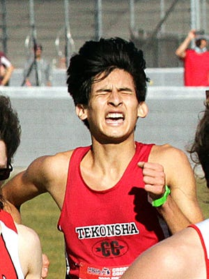 Tekonsha's Marco Barron gives it his all as he heads to the finish Saturday at the D4 XC state finals.