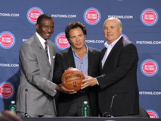 New Pistons head coach Dwane Casey, owner Tom Gores and senior adviser Ed Stefanski on Wednesday at Little Caesars Arena.