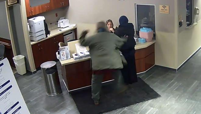 This screen grab from surveillance video, provided by attorney Majed Moughni, shows a man attacking a 19-year-old woman in lobby of the emergency room at Beaumont Hospital in Dearborn.