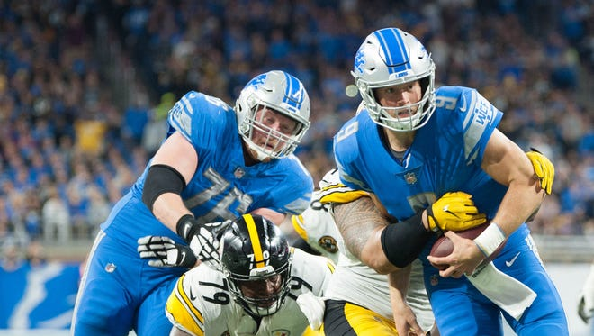 Lions offensive linemen Travis Swanson (64) and T.J. Lang (76) watch as Matthew Stafford is tackled short of the goal line on fourth down in the third quarter of the 20-15 loss to the Steelers at Ford Field on Sunday, Oct. 29, 2017.