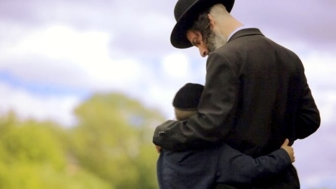 """This undated photo provided by Channel 8 and Go2Films shows Ori Gruder and his son David acting in a scene from the """"Sacred Sperm"""" movie Gruder directed. The film has been screened at festivals in Israel, London and California and continues in the coming weeks to other U.S. locations, including Atlanta on Feb. 15, 2015. Gruder created """"Sacred Sperm,"""" an hour-long documentary in which he tries to tackle the hard questions he can expect from his son. (AP Photo/Gliad Kavalerchik)"""