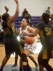 Loyola's Chelsea Johnson tries to score against Green