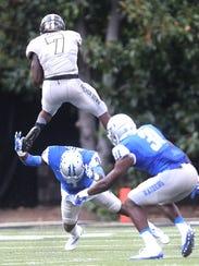 Vanderbilt running back Ralph Webb (7) goes up over
