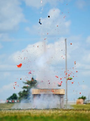A watermelon explodes after being hit by a mortar during a fireworks safety demonstration put on by Sioux Falls Fire Rescue Thursday, June 30, 2016, at the W.H. Lyon Fairgrounds in Sioux Falls.