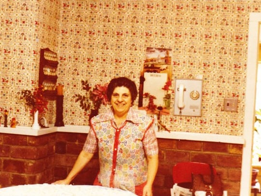 Louis Giancola's mother, Catherine Giancola, in her kitchen.