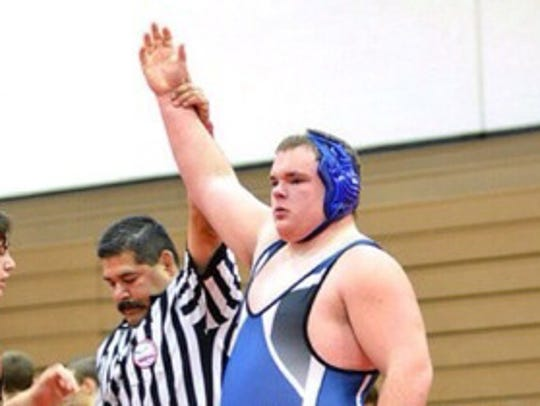 Caleb Masten during the 2013-14 wrestling season