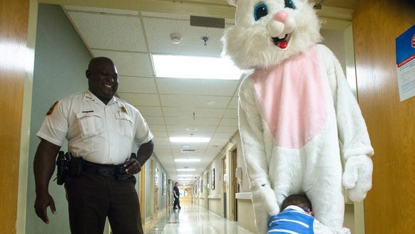 Landen Martin, 2, hugs the Easter Bunny, played by