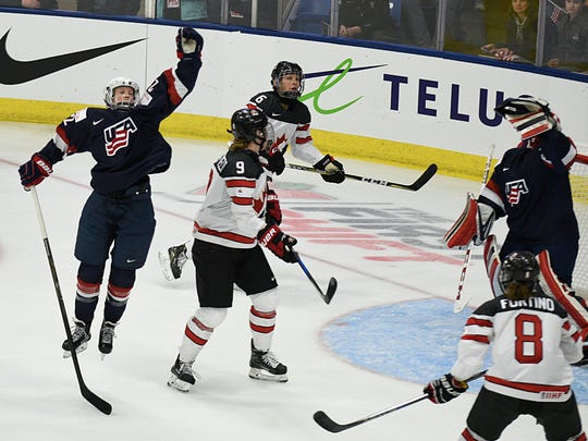 Team USA goalie Nicole Hensley (29), who was outstanding in the clutch, and defenseman Kacey Bellamy try to flag down a knuckling puck.