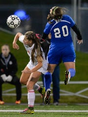 Sartell's Brooke Walters (20) heads the ball over the head of St. Cloud Tech's Emilie Miller in the first half Sept. 27 at Husky Stadium.