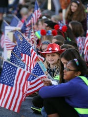 Silver Bay Elementary School 5th Grader Felicia Miller, 10, sports a patriotic hat along the parade route during the Toms River Veterans Day parade Monday, November 14, 2016.