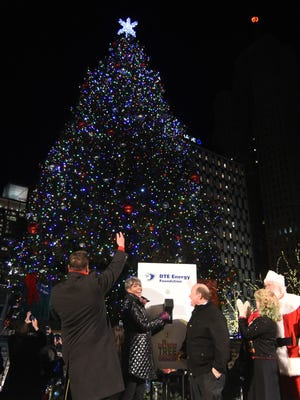 Detroit Mayor Mike Duggan lights up the tree in Campus Martius along with Stephen Clark Channel 7 broadcaster and Faye Nelson, president of the DTE Energy Foundation during the downtown Detroit holiday festivities on Nov. 21.