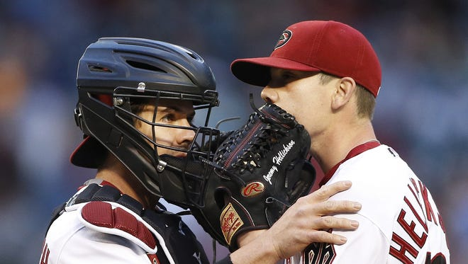 Diamondbacks' Tuffy Gosewisch (9) comes to the mound to talk to pitcher Jeremy Hellickson (58) at Chase Field in Phoenix, AZ on May 8, 2015.