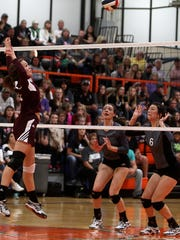 Bronte Longhorn Emily Whitehurst jumps up to block the ball during theRegion I-1A Finals against the Water Valley Lady Cats inside the Central High School Gym Saturday, Nov. 12, 2016.
