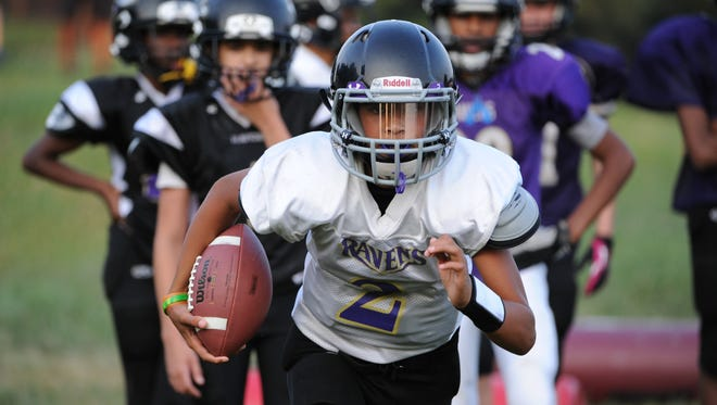 """Jared Morson, 13, plays football in Olney, Md., although his mother, Michelle, admits, """"Every play makes me nervous."""""""