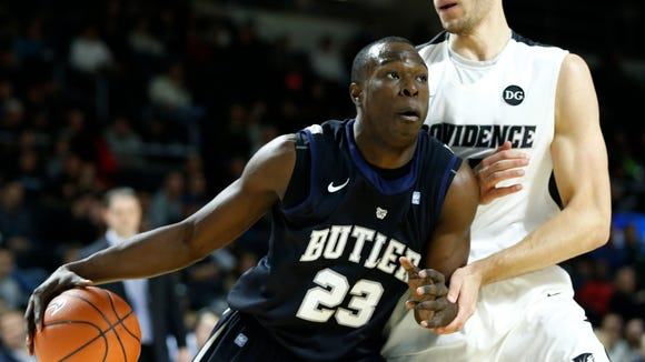 Jan 21, 2014; Providence, RI, USA; Butler Bulldogs forward Khyle Marshall (23) dribbles the ball as Providence Friars forward Carson Desrosiers (33) defends during the second half at Dunkin Donuts Center.