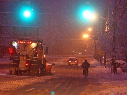 After working the overnight shift at a diner, a man bicycled home through the snow on Route 9 in Tarrytown Saturday morning.