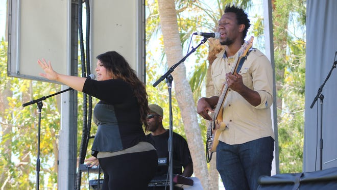 Nickardo Salmon, right, sings alongside his wife, Drea, and their SWFL reggae/R&B band, NostalJah.