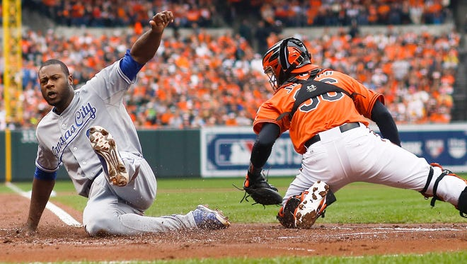 The Royals' Lorenzo Cain scores in the first inning Saturday during a 6-4 victory over the Orioles in Game 2 of the ALCS.