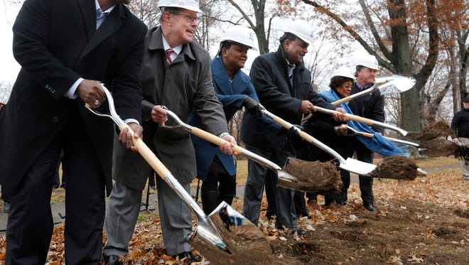 Dignitaries from MSD, Metro Parks Department and others turned the first shovels of dirt on the $60 million Shawnee Park basin project. the 20 milion gallon underground basin will will hold untreated wastewater from entering the Ohio river. Dec. 6, 2016.