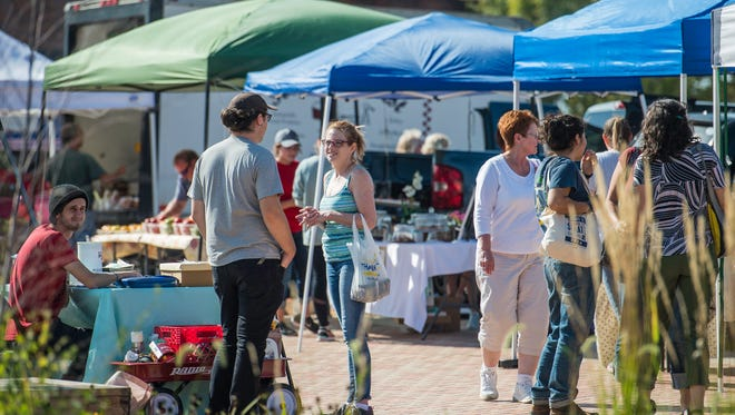 People enjoy the Richmond Farmers Market at Elstro Plaza in 2017. The outdoor market will return for the season beginning this Saturday.