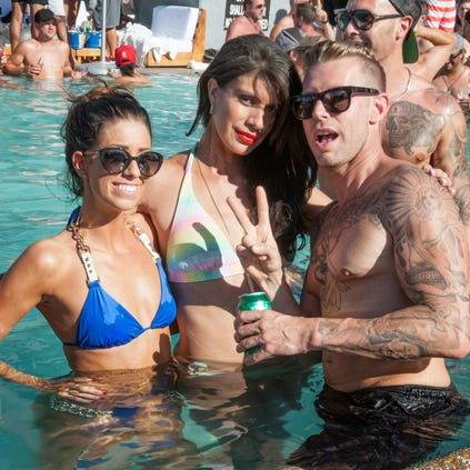 Friends enjoy the weather and pool during The W Scottsdale Hotel's Labor Day Weekend festivities on Saturday, Aug. 30, 2014.