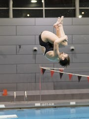 Amelia's Morgan Southall flips through the air in qualifying for the state meet.