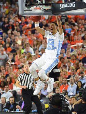 North Carolina Tar Heels forward Justin Jackson (44) dunks against the Syracuse Orange in the second half in the 2016 NCAA Men's Division I Championship semifinal game at NRG Stadium.