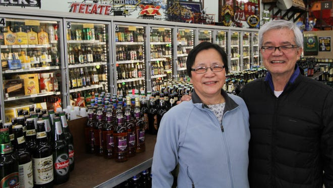 Capital Market owners Henry and Christy Fu pride themselves on their store's beer and cider selection.