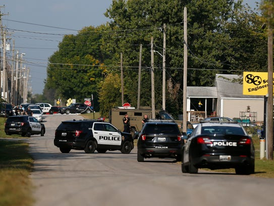Police surround a house at 1400 West Phelps after a
