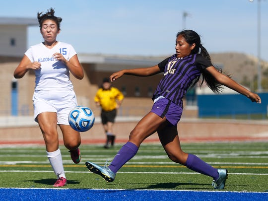 Kirtland Central's Nikki Begay takes a shot on goal