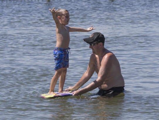 Father and son play at the Ship Bottom Bay Beach.