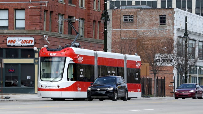 The QLine heads south on Woodward in Detroit on Tuesday, April 11, 2017.