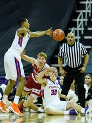 University of Evansville's Ryan Taylor (0) recovers
