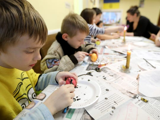 Daniel Fedorko, 8, uses a stylus,or kistka, with beeswax to decorate an egg in Clifton.