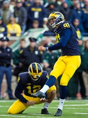 Michigan kicker Kenny Allen (91) kicks a field goal against Michigan State in Ann Arbor on Oct. 17, 2015.
