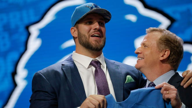 Taylor Decker of Ohio State holds up a jersey with NFL Commissioner Roger Goodell after being picked #16 overall by the Detroit Lions during the first round of the 2016 NFL Draft at the Auditorium Theatre of Roosevelt University on April 28, 2016 in Chicago, Illinois.