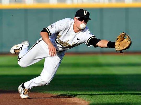 Vanderbilt's Tyler Campbell dives for the ball hit