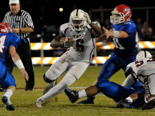 Dee Thompson, No. 6 of the Tate Aggies, weaves his way through the Pace Patriots defense. The Aggies hold the No. 2 spot in this week's power poll.
