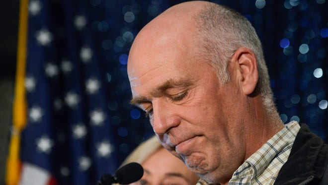In this May 25, 2017, file photo, Greg Gianforte celebrates his win over Rob Quist for Montana's open congressional seat in Bozeman, Montana.