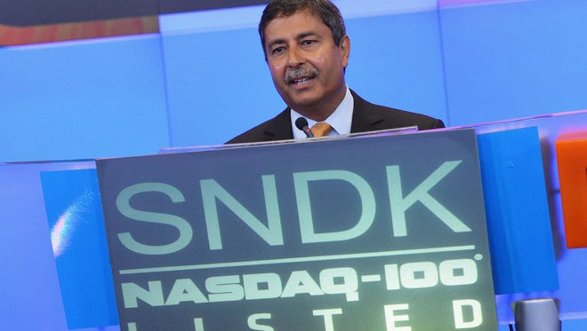 Sanjay Mehrotra, President, Chief Executive Officer and Co-Founder of SanDisk Corporation, rings the Opening Bell at the Nasdaq MarketSite in 2013.