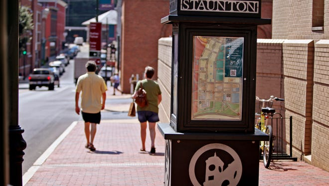 Shoppers stroll around downtown Staunton on Tuesday, Sept. 13, 2016.