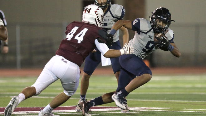 Del Valle running back Adrian Vazquez tries to avoid Ysleta defensive end Alonso Rincon on Sept. 16.