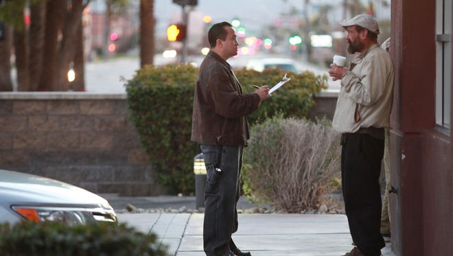 Jesus Gomez, left, talks with Allen Frost early Tuesday morning in Indio.  Frost made an appointment for some help later that day. Gomez was one of several surveying and counting the Coachella Valley's homeless, January 24, 2017.