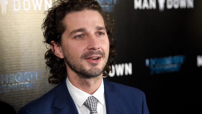 "In this Nov. 30, 2016 file photo, Shia LaBeouf arrives at the Los Angeles premiere of ""Man Down"" at ArcLight Cinemas Hollywood. LaBeouf has been arrested early Thursday morning, Jan. 26, 2017, after he allegedly got into an altercation with another man outside a New York City museum. Police say LaBeouf pulled the scarf of an unidentified 25-year-old man early Thursday morning outside the Museum of the Moving Image in Queens, scratching his face in the process."