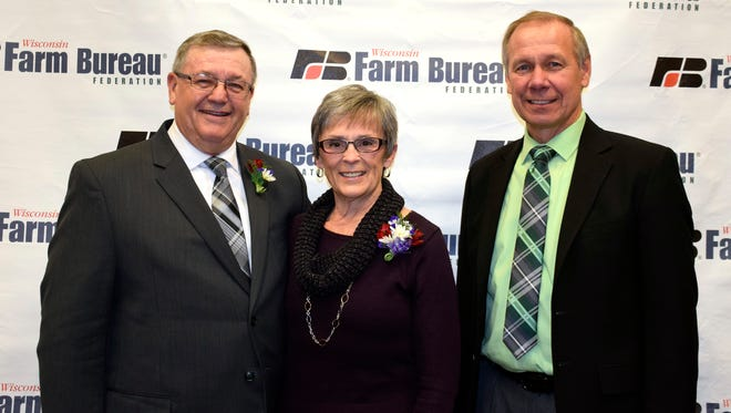 Wisconsin Farm Bureau President Jim Holte (right) presents former WFBF President Bill Bruins with the 'Distinguished Service to Wisconsin Agriculture' award for his outstanding contributions to Wisconsin's agricultural industry during the Wisconsin Farm Bureau Federation's 98th Annual Meeting in Wisconsin Dells on December 3.