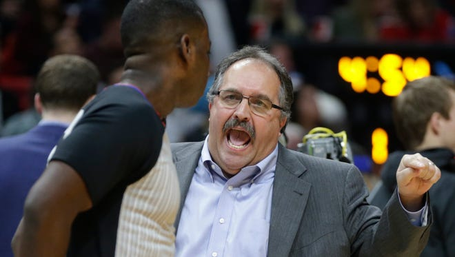 Detroit Pistons' Stan Van Gundy, right, talks with official James Williams during the first half of an NBA basketball game against the Miami Heat, Wednesday, Jan. 3, 2018, in Miami.